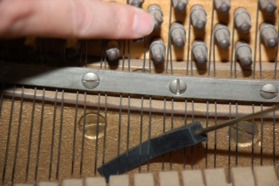 Piano string muted with a rubber mute